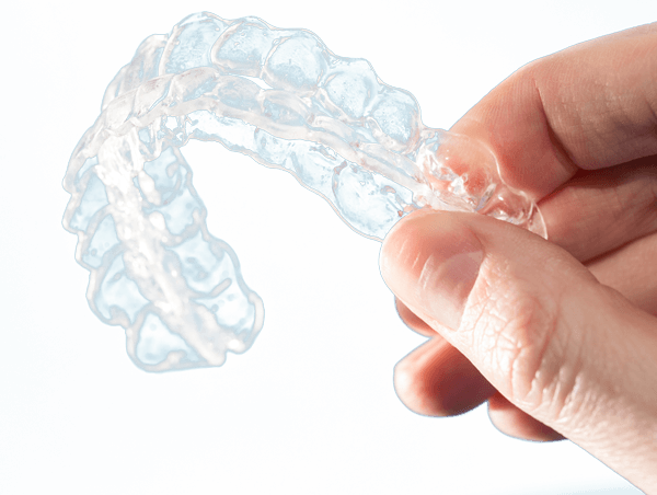 hand holding upper and lower invisalign aligners